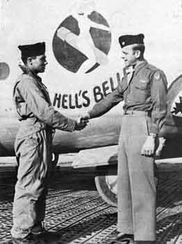 William Beard, Sr. is greeted by Walt Cannon, 756th C. O., after returning from aircraft's 100th mission B-24 44-40926 Hell's Belle