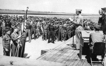 Col Mooney,CO of 459 BG Announcing End of European War May8,1945 to Assembled Group Personnel