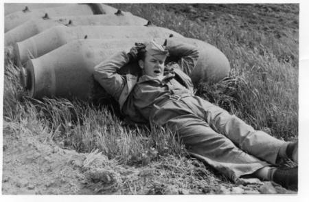 459 BG  759 BS Ground Crewman at work??-Resting on 500 lb Bomb 1944