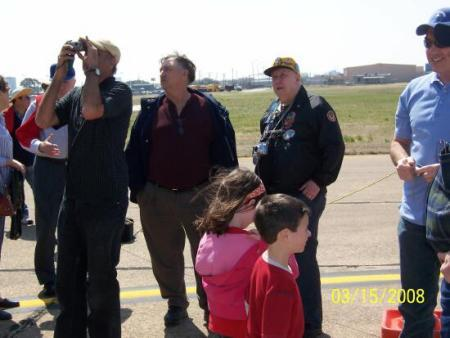 Reid Waltman (center) watches P-51 buzz Love Field