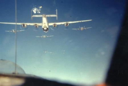 459 BG  759 BS 6 plane Formation Throwing Chaff( Alum.Foil) on route to target1944, 88 mm Flak Bursts(White)