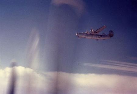 Lone B-24 Vapor Trails