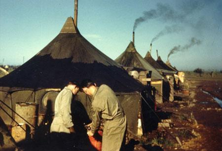 459 BG  759 BS  Officer`s Tents- Notice Filling up Stove Tank With 100 Octane Aviation Gas For Stove Inside Tent
