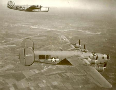 459th BG 757th BS B-24s in formation-Unmarked ship probably New Mickey(Radar) ship-1944