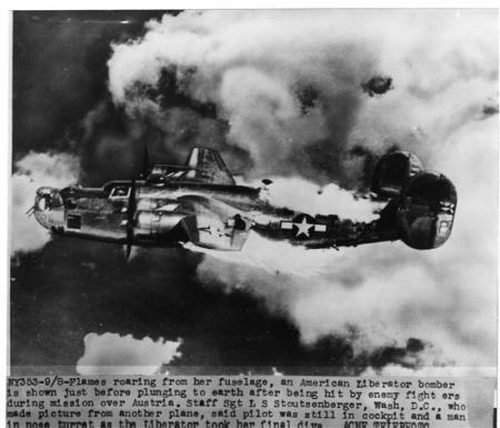 B-24s over Vienna, Austria in 1944--on fire from enemy attack