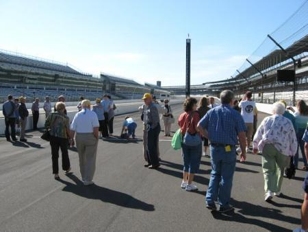 The group walking the track at Indy