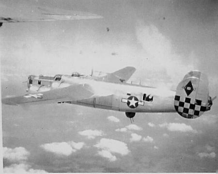 One of 758 Bomb Squadron `s B-24s in flight,probably new Mickey ship prior to being painted 1944