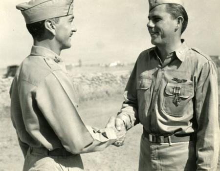 Lt Ogle Receiving the DFC Medal from Col Mooney, CO of the 459th BG