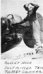 Unknown crew member showing battle damage on the rear turret