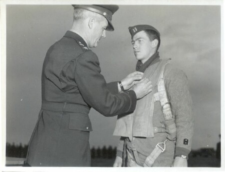 Captain Ellis A. Goodrich, of 206 North Cedar Street, Jefferson, Iowa, member of the 15th Air Force in Italy, is decorated by his commander, Gen. Nathan F. Twining, with the Distinguished Flying Cross - 459th BG, Army Air Corps Library and Museum