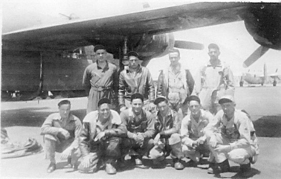 Tech/Sgt Morris Fishbein-Radio Operator/Mechanic/Waist Gunner- with his crew,1st row 3rd from left on the hardstand next to his B-24,Giulia Field, Italy,1945. - 459th BG, Army Air Corps Library and Museum