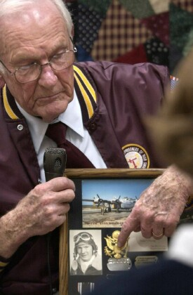 Jerry Gleesing shows mementos of his time in the service. - 459th BG, Army Air Corps Library and Museum